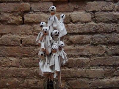 Fantasmas de Halloween hechos con chupachups