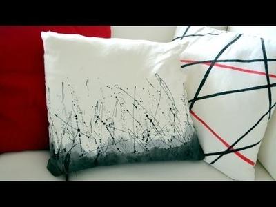 Cojín decorado con manchas de pintura
