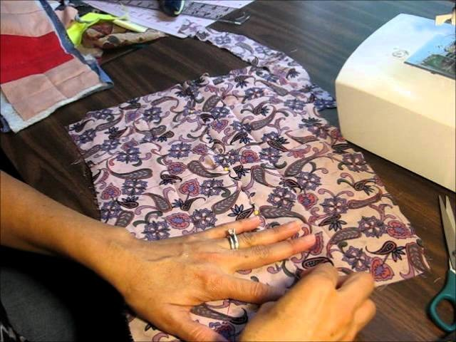 Tutorial como enguatar y ensamblar un quilt o colcha con el metodo facil.wmv