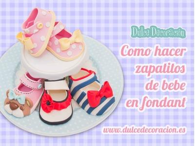 Como hacer zapatos de bebé en fondant . how to make baby girl shoes