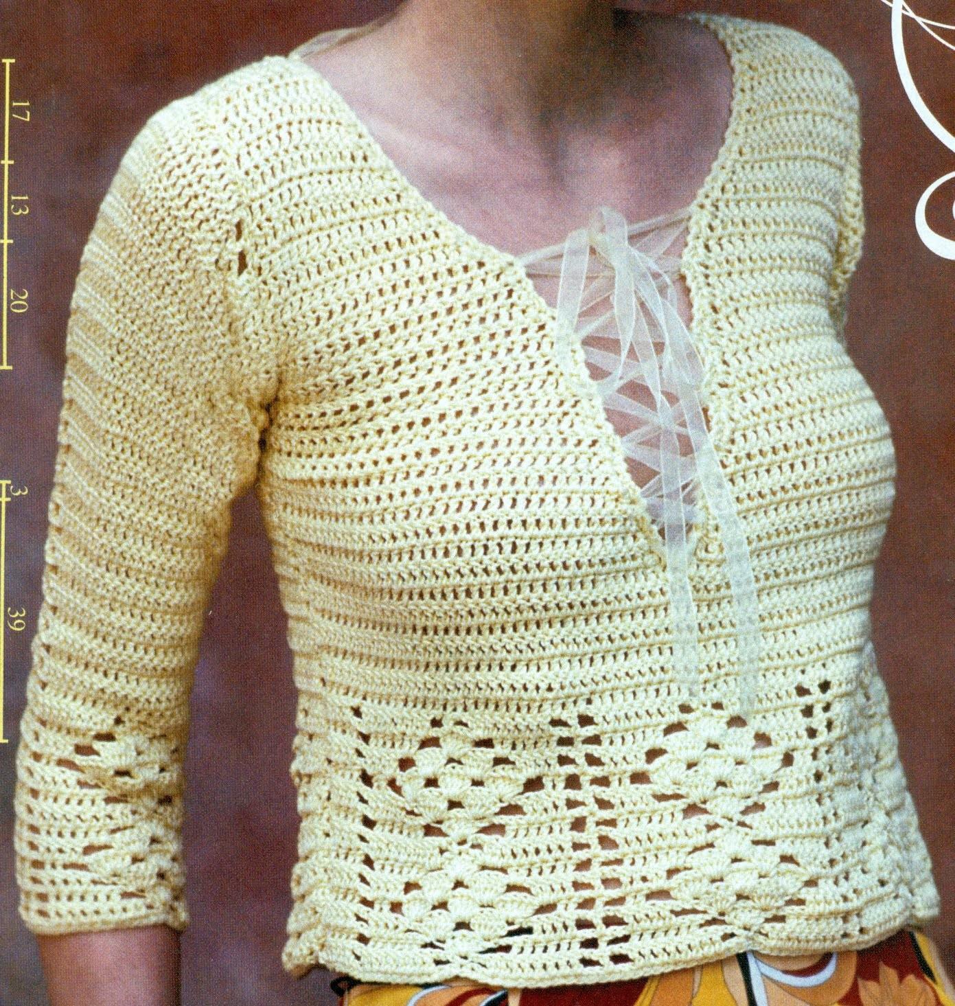 Suéter corto con listón a crochet