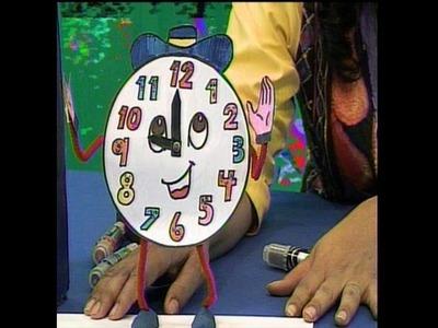 Carita simpática de reloj para niños en cuenticos.