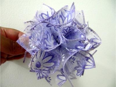 Moños flor pompones en cintas de organza para el cabello