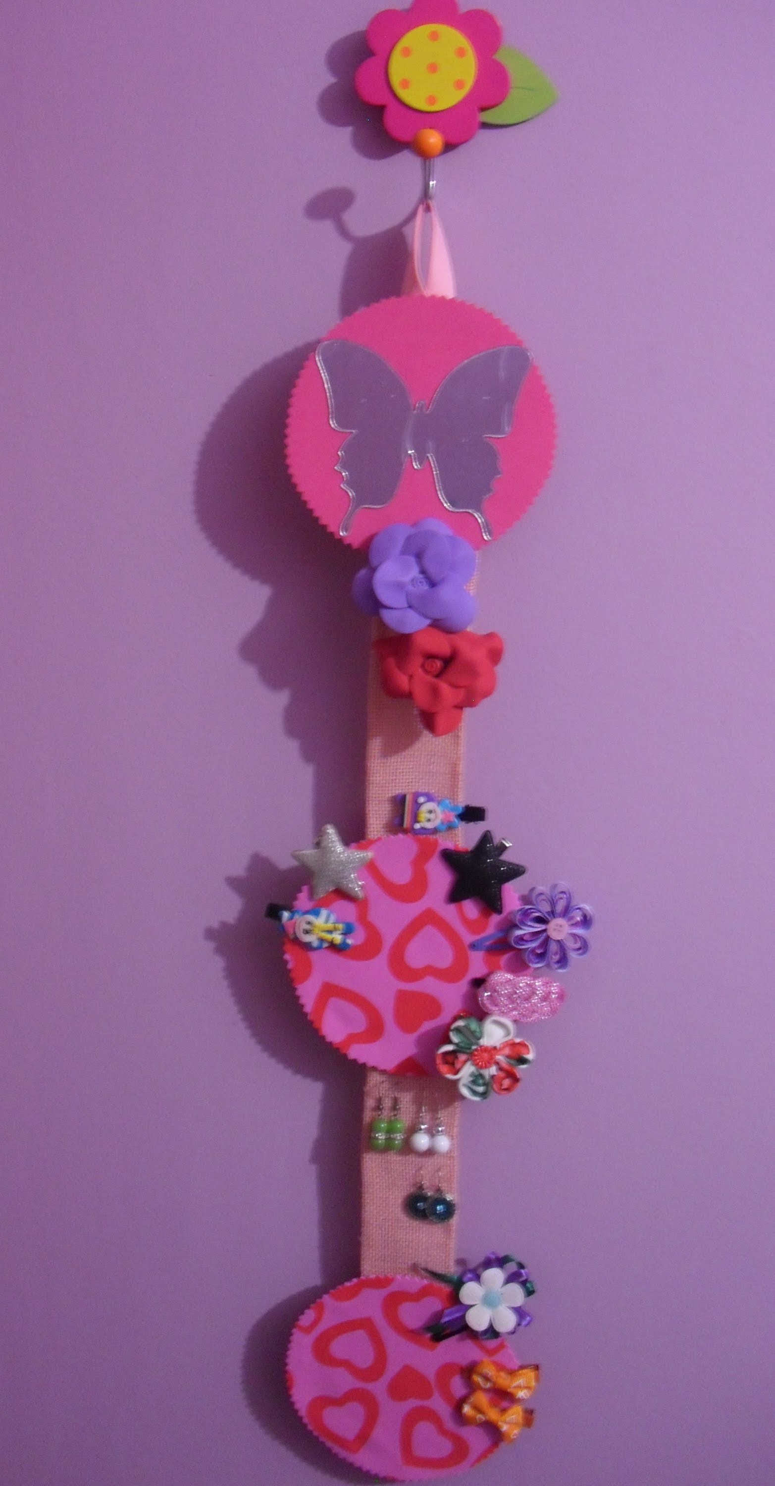 Organiza tus broches, pendientes y horquillas. organizer of earrings, brooches, and hair pins