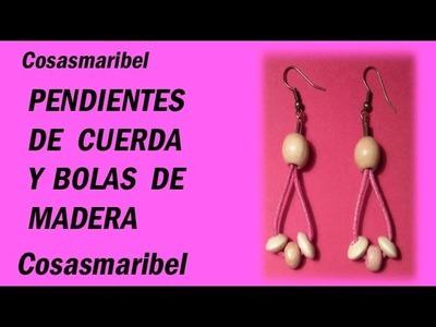 Pendientes de cuerda rosa y bolas de madera.