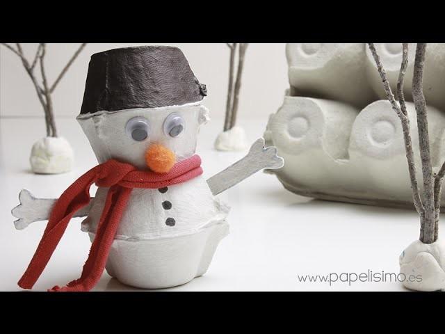 Muñeco de nieve con caja de huevos
