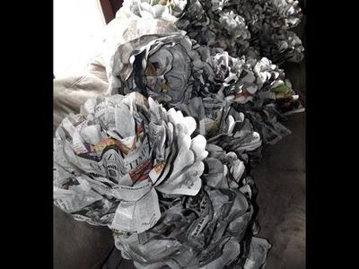 Como hacer rosas de papel periodico