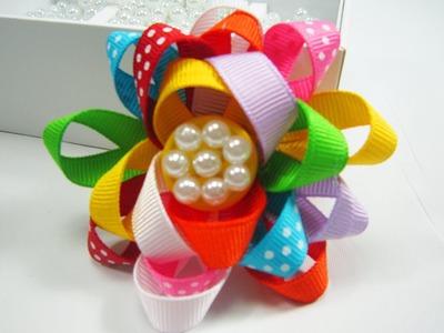 Episodio 526 - Cómo hacer una flor festiva multicolor con cintas de gro
