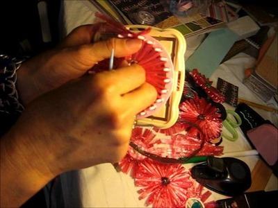 Tutorial como hacer una flor de rafia.wmv