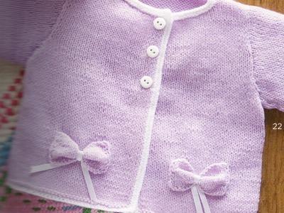 Suéter con moños para niña bebé 2 agujas
