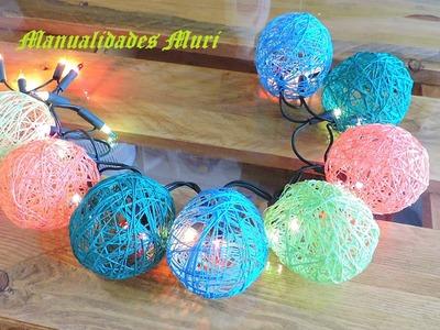Manualidades. Decora las luces de Navidad con bolas de hilos