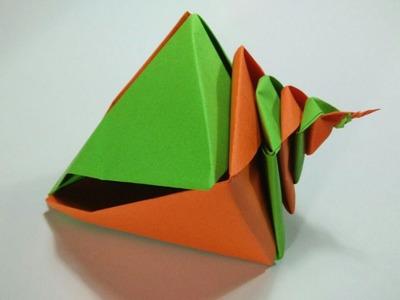 Como hacer una caracola de papel