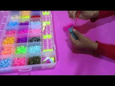 Como hacer  una pulsera de gomita de trenza francesa con telar | tutorial | paso a paso | 2015