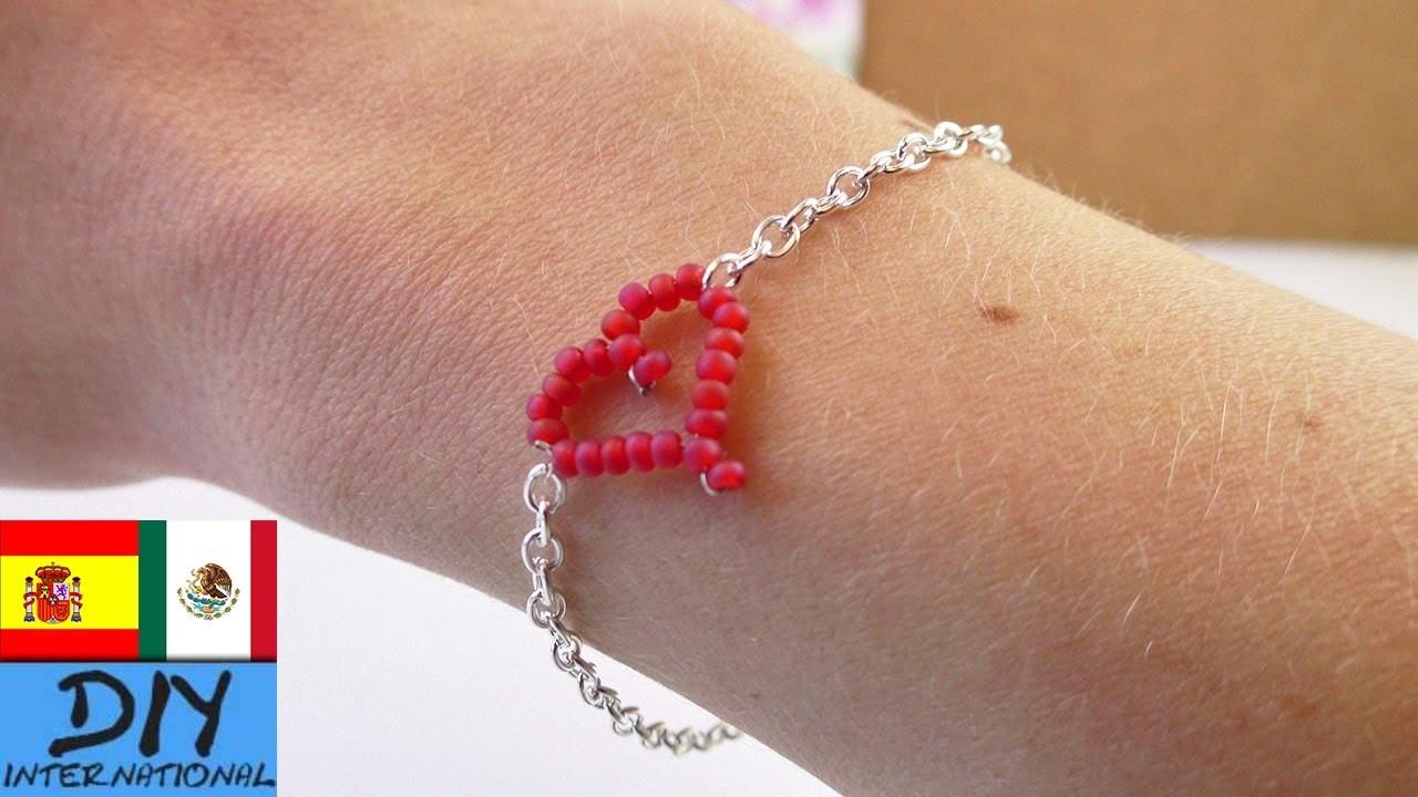 DIY Brazalete con corazón de perlas.mostacillas
