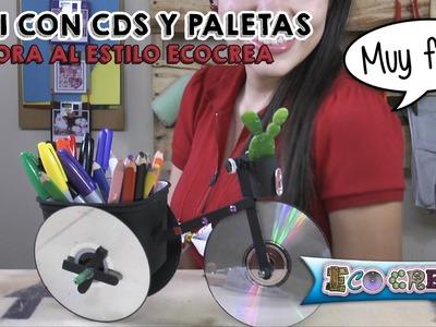 Bicicleta con CDs y paletas