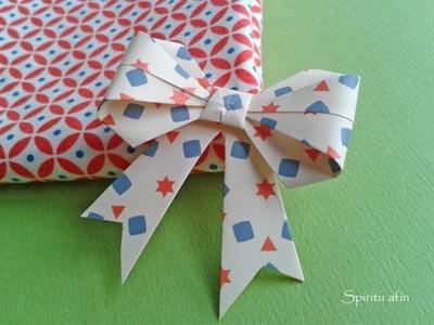 Origami lazo de decoración para regalo vea paso a paso