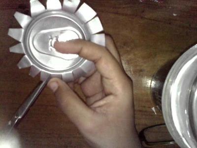 Como hacer una flor con latas de aluminio 1ra parte