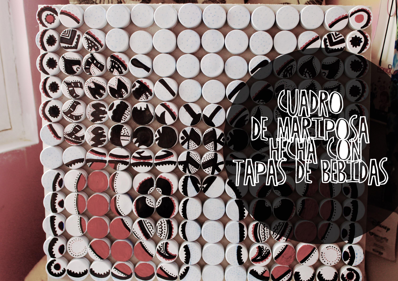 Cuadro de mariposa hecha con tapas de bebidas. butterfly made with beverage caps