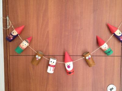 Especial de navidad: banner con rollos.tubos de papel reciclado para decorar la puerta