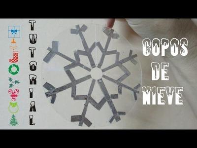 Cómo hacer copos de nieve con separadores de CDs