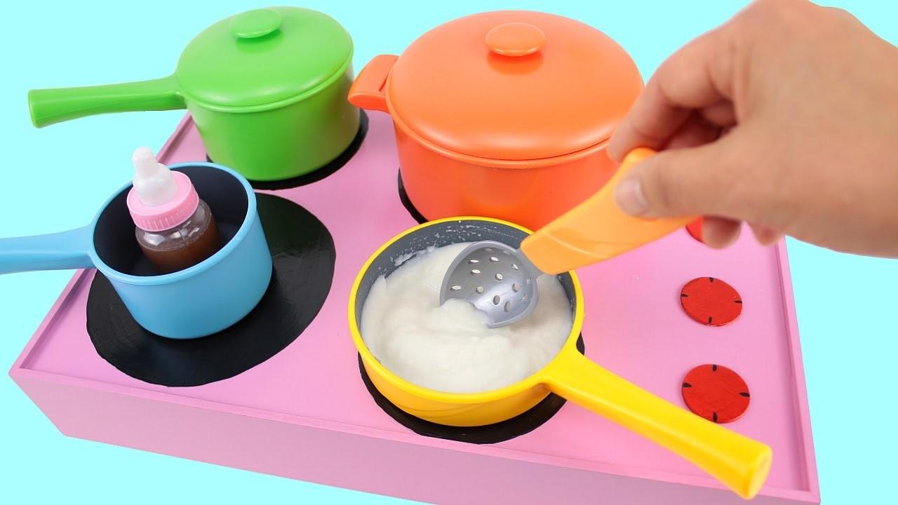 Trastecitos de juguete y diseñamos  una  estufa de Juguete para hacer arroz con leche