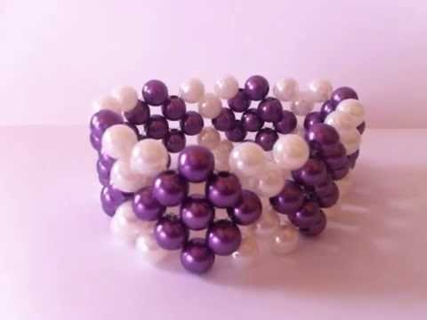 Pulcera de perlas moradas con blanco (ROMBOS)