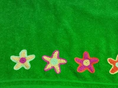 Toalla con flores de crochet